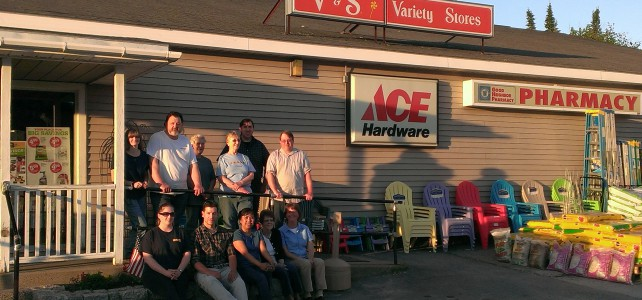 Island Employee Cooperative board standing in front of one of the stores they bought on June 11, 2014, becoming Maine's largest worker-owned cooperative.