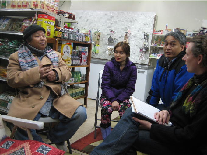 Matt Meyer, CDI housing co-op specialist, talking with members of the Karen tribe living in Hartford, CT, in Saw Than's Asian grocery market.