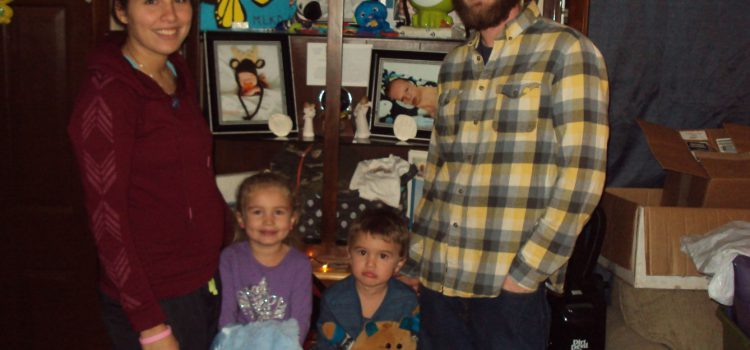 Patricia and Todd Donahue and their children, Raelyn, left, and Tripp, with keepsakes from Mason Donahue, who died at 36 days old from sudden infant death syndrome in May.