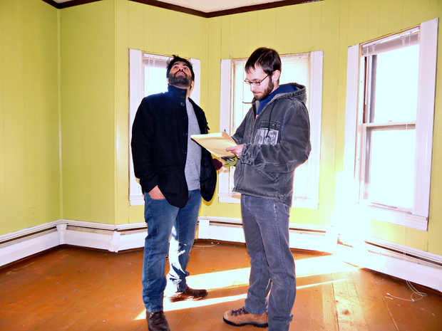 Craig Saddlemire and Shaad Masood inspect a third-floor bedroom in the building recently purchased by the newly formed Raise Op housing cooperative. The building should be ready for occupants in 2015 and is the first in what members hope will be many new cooperative housing units.