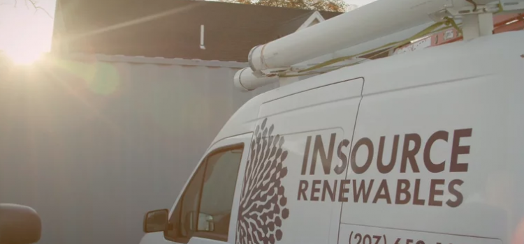 A sun rises over a fence in the background. A truck with the words Insource Renewables is parked in the foreground