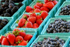 Cartons of strawberries and blueberries